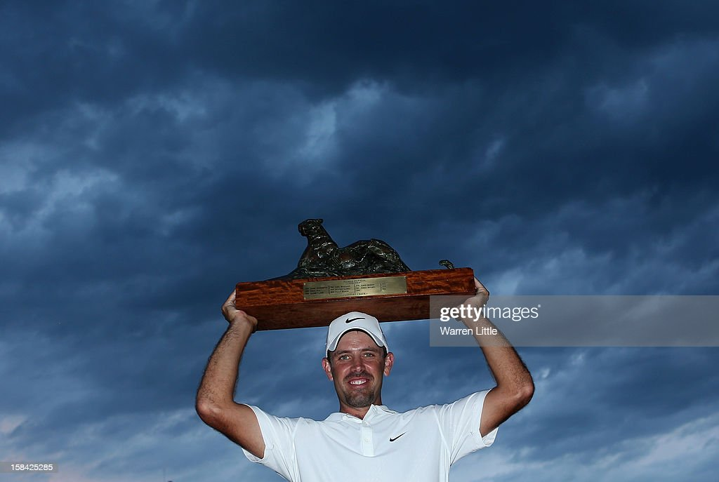Charl Schwartzel of South Africa poses with the trophy after winning the Alfred Dunhill Championship on a score of -24 at Leopard Creek Country Golf Club on December 16, 2012 in Malelane, South Africa.