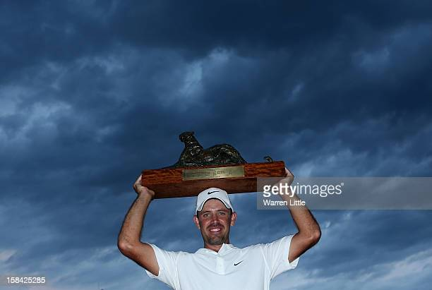 Charl Schwartzel of South Africa poses with the trophy after winning the Alfred Dunhill Championship on a score of 24 at Leopard Creek Country Golf...