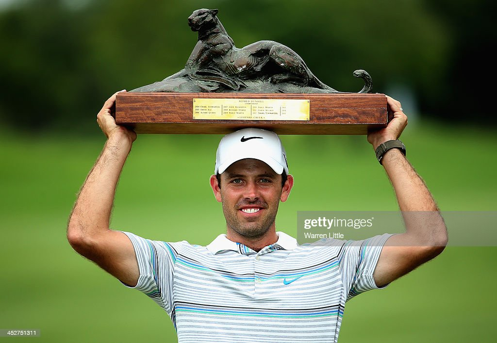 <a gi-track='captionPersonalityLinkClicked' href=/galleries/search?phrase=Charl+Schwartzel&family=editorial&specificpeople=213793 ng-click='$event.stopPropagation()'>Charl Schwartzel</a> of South Africa poses with the trophy after winning the Alfred Dunhill Championship on a score of -17 under par at Leopard Creek Country Club on December 1, 2013 in Malelane, South Africa.