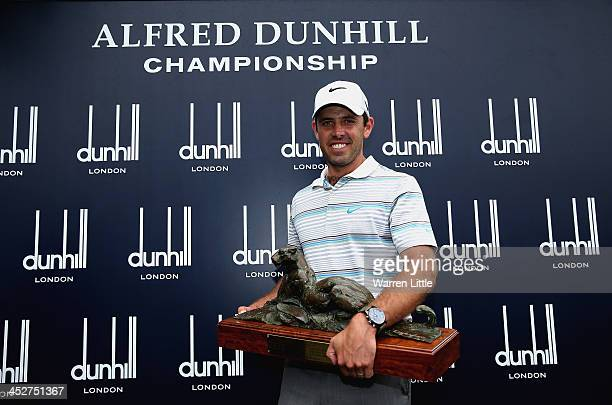 Charl Schwartzel of South Africa poses with the trophy after winning the Alfred Dunhill Championship on a score of 17 under par at Leopard Creek...