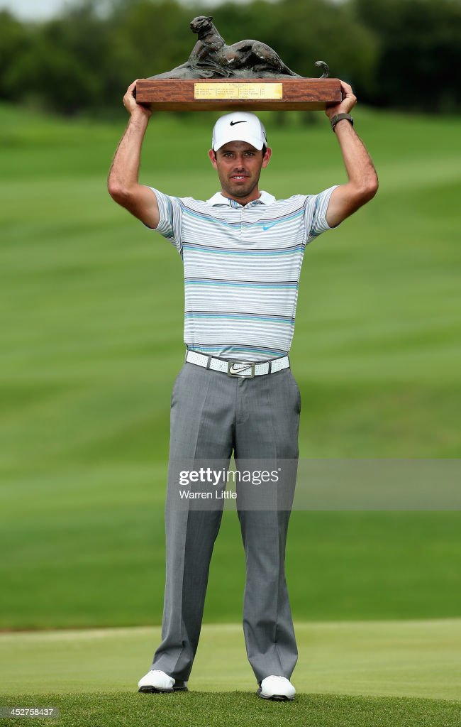 Charl Schwartzel of South Africa poses with the trophy after winning the Alfred Dunhill Championship on a score of -17 under par at Leopard Creek Country Club on December 1, 2013 in Malelane, South Africa.