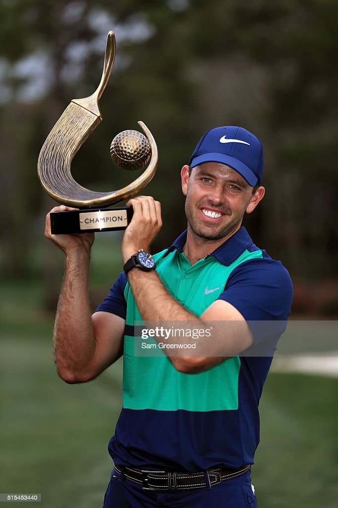 Charl Schwartzel of South Africa poses with the trophy after winning the Valspar Championship during the final round at Innisbrook Resort Copperhead Course on March 13, 2016 in Palm Harbor, Florida.