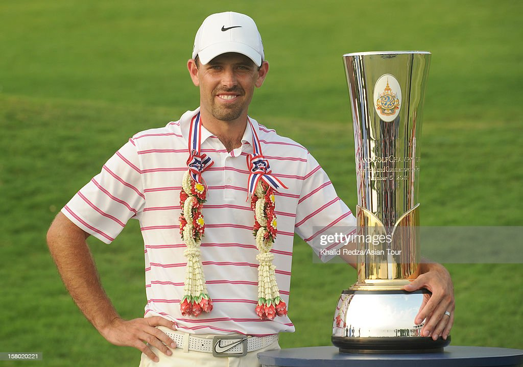 Charl Schwartzel of South Africa posing with the trophy after winning of the Thailand Golf Championship at Amata Spring Country Club on December 9, 2012 in Bangkok, Thailand.