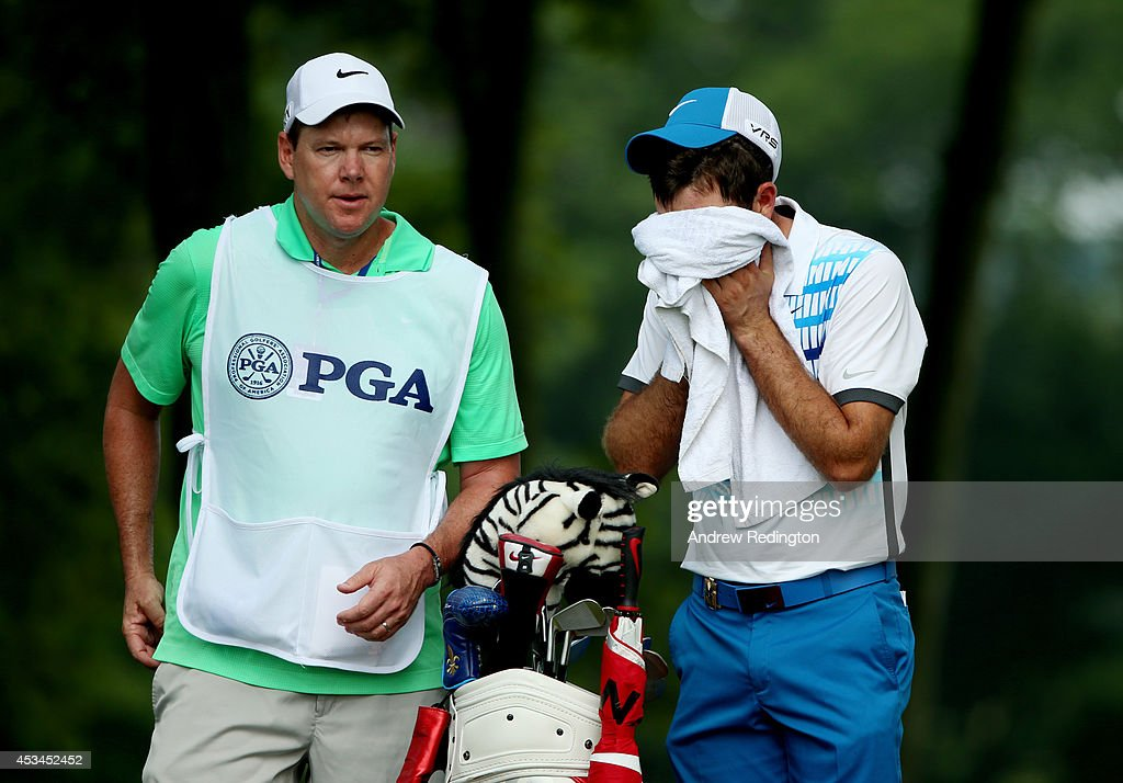 Charl Schwartzel of South Africa prepares to hit his tee shot on the 12th hole during the final round of the 96th PGA Championship at Valhalla Golf Club on August 10, 2014 in Louisville, Kentucky.