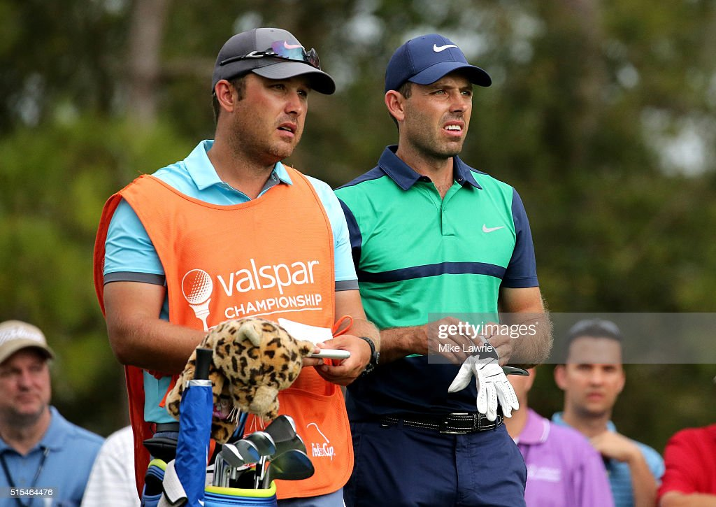 Charl Schwartzel of South Africa prepares to hit off the 15th tee as his caddie and brother Adrian Schwartzel looks on during the final round of the...
