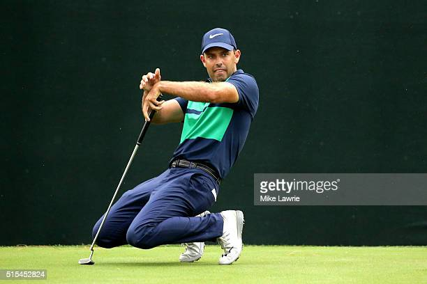 Charl Schwartzel of South Africa reacts after a putt on the 18th green during the final round of the Valspar Championship at Innisbrook Resort...