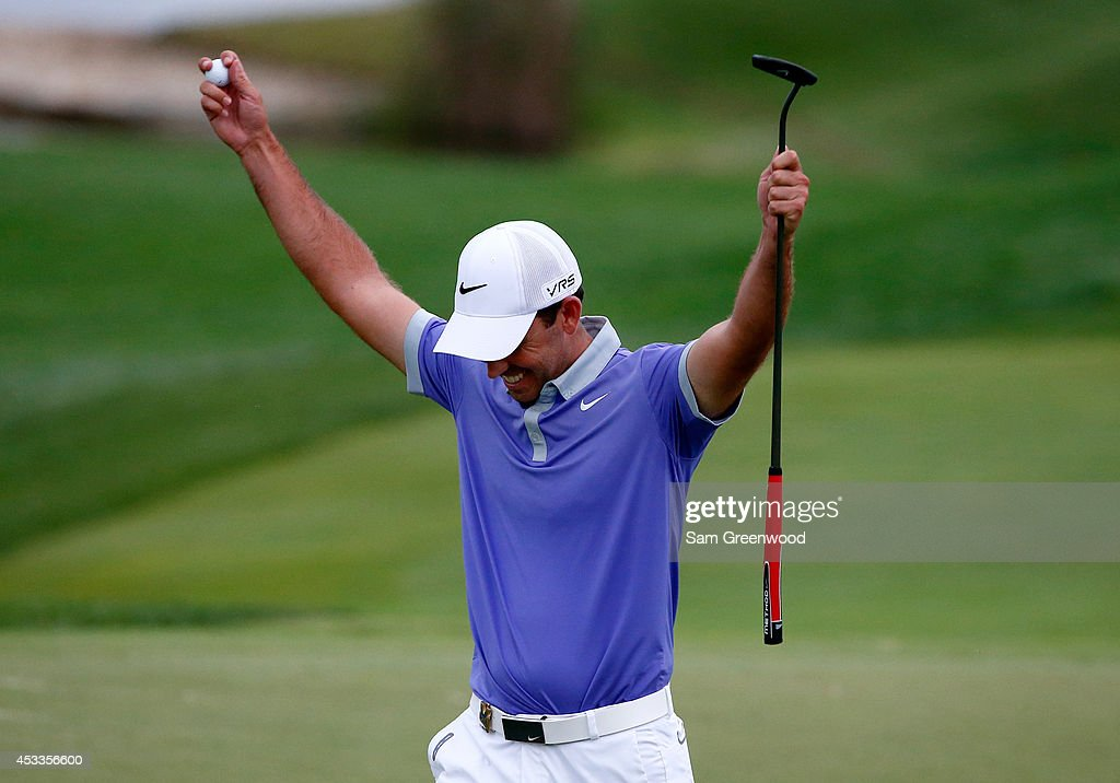 Charl Schwartzel of South Africa reacts on the 18th green during the second round of the 96th PGA Championship at Valhalla Golf Club on August 8, 2014 in Louisville, Kentucky.