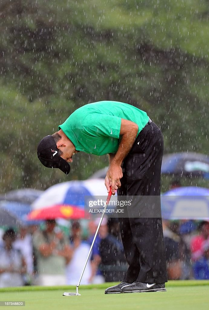 Charl Schwartzel of South Africa reacts to a bad shot on the 7th green during the 2012 Nedbank Golf Challenge in Sun City on December 2 ,2012. PHOTO / Alexander Joe