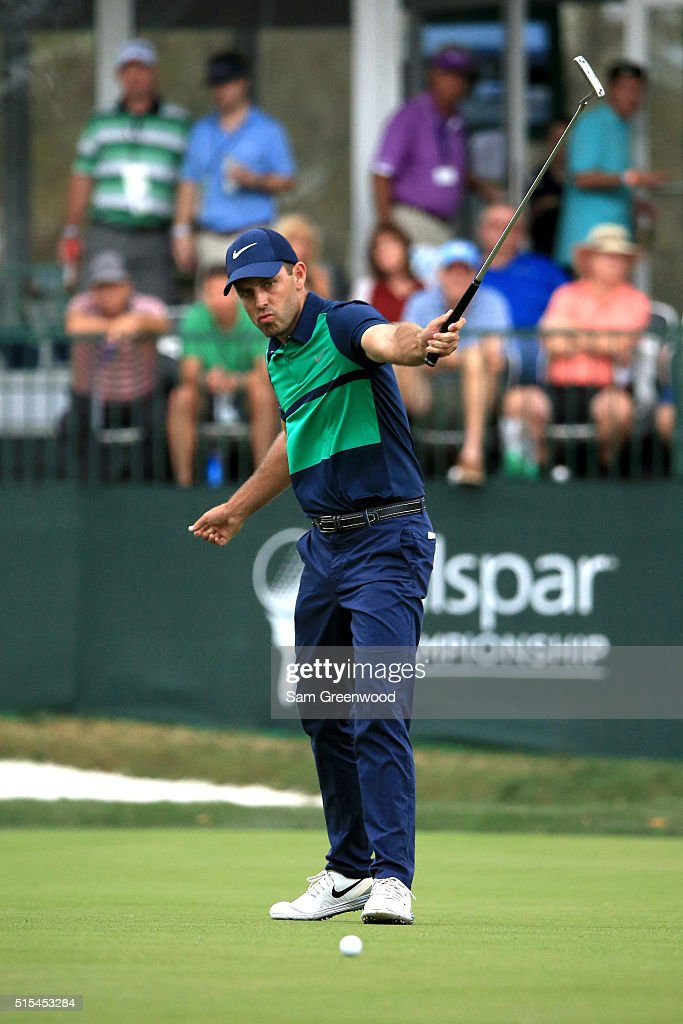 Charl Schwartzel of South Africa reacts to a birdie putt on the 17th green during the final round of the Valspar Championship at Innisbrook Resort Copperhead Course on March 13, 2016 in Palm Harbor, Florida.