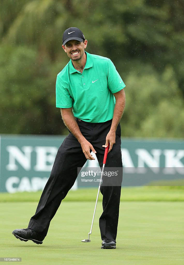 <a gi-track='captionPersonalityLinkClicked' href=/galleries/search?phrase=Charl+Schwartzel&family=editorial&specificpeople=213793 ng-click='$event.stopPropagation()'>Charl Schwartzel</a> of South Africa reacts to a missed outt on the 18th green during the final round of the Nedbank Golf Challenge at the Gary Player Country Club on December 2, 2012 in Sun City, South Africa.