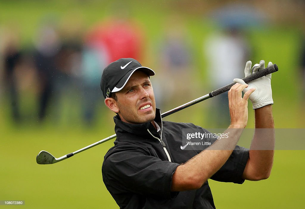 Charl Schwartzel of South Africa reacts to a poor second shot on the 14th hole during the fourth round of the Joburg Open at Royal Johannesburg and Kensington Golf Club on January 16, 2011 in Johannesburg, South Africa.