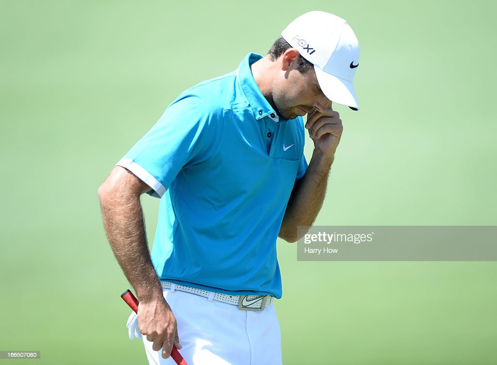 Charl Schwartzel of South Africa reacts to making bogey on the second hole during the third round of the 2013 Masters Tournament at Augusta National...