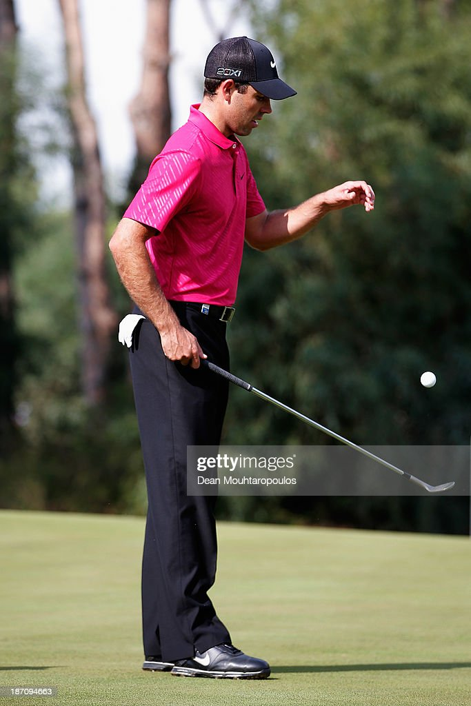 Charl Schwartzel of South Africa scoops his ball up on the 2nd green during the pro-am as a preview for the Turkish Airlines Open at Montgomerie Maxx Royal Course on November 6, 2013 in Antalya, Turkey.