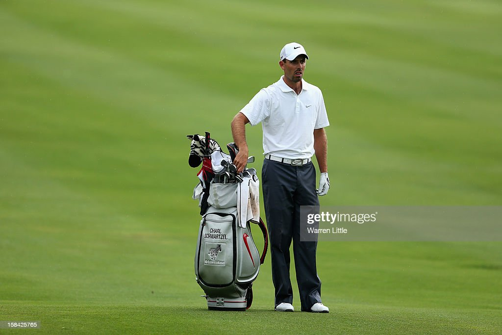 Charl Schwartzel of South Africa selects a club during the final round of the Alfred Dunhill Championship at Leopard Creek Country Golf Club on December 16, 2012 in Malelane, South Africa.