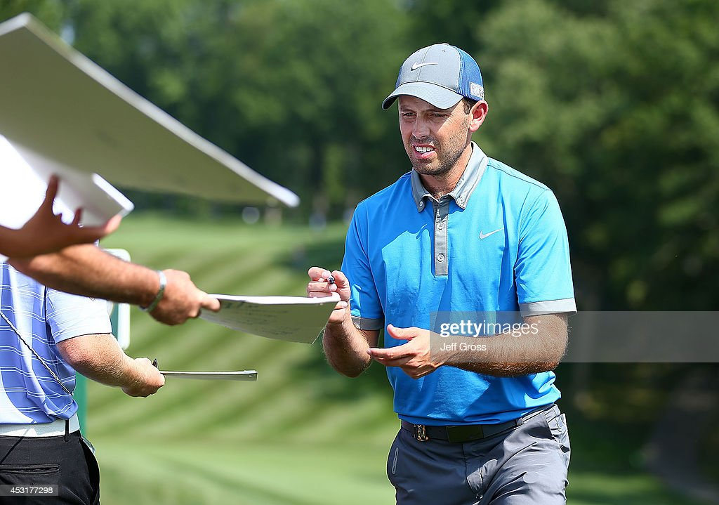 Charl Schwartzel of South Africa signs autographs for fans during a practice round prior to the start of the 96th PGA Championship at Valhalla Golf Club on August 4, 2014 in Louisville, Kentucky.