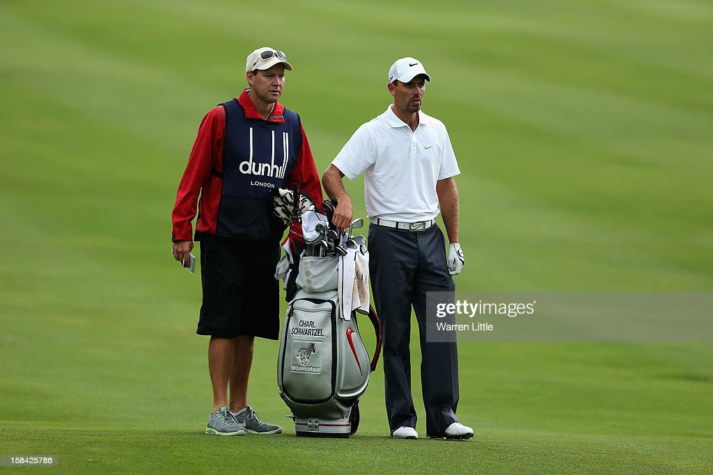 Charl Schwartzel of South Africa stands with his caddie Glem Murray during the final round of the Alfred Dunhill Championship at Leopard Creek Country Golf Club on December 16, 2012 in Malelane, South Africa.