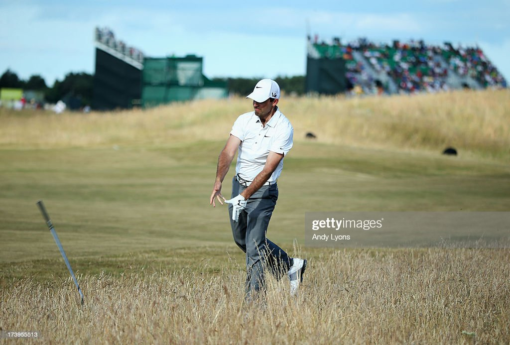 Charl Schwartzel of South Africa throws his club in reaction to a shot on the 15th hole during the first round of the 142nd Open Championship at Muirfield on July 18, 2013 in Gullane, Scotland.
