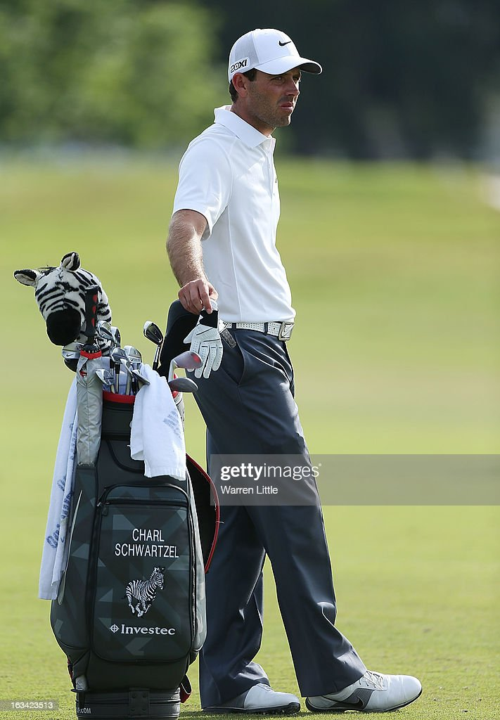 Charl Schwartzel of South Africa waits in a fairway during the third round of the World Golf Championships-Cadillac Championship at the Trump Doral Golf Resort & Spa on March 9, 2013 in Doral, Florida.