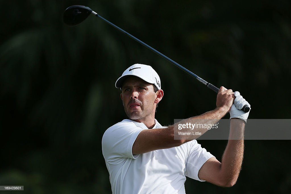 Charl Schwartzel of South Africa watches a shot during the third round of the World Golf Championships-Cadillac Championship at the Trump Doral Golf Resort & Spa on March 9, 2013 in Doral, Florida.