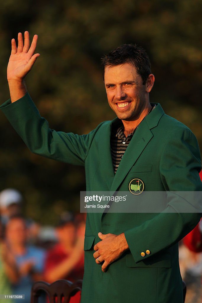 Charl Schwartzel of South Africa waves to the gallery at the green jacket presentation after his two-stroke victory at the 2011 Masters Tournament at Augusta National Golf Club on April 10, 2011 in Augusta, Georgia.