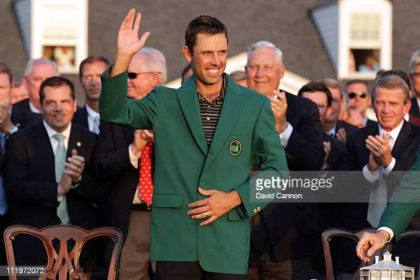 Charl Schwartzel of South Africa waves to the gallery at the green jacket presentation after his twostroke victory at the 2011 Masters Tournament at...