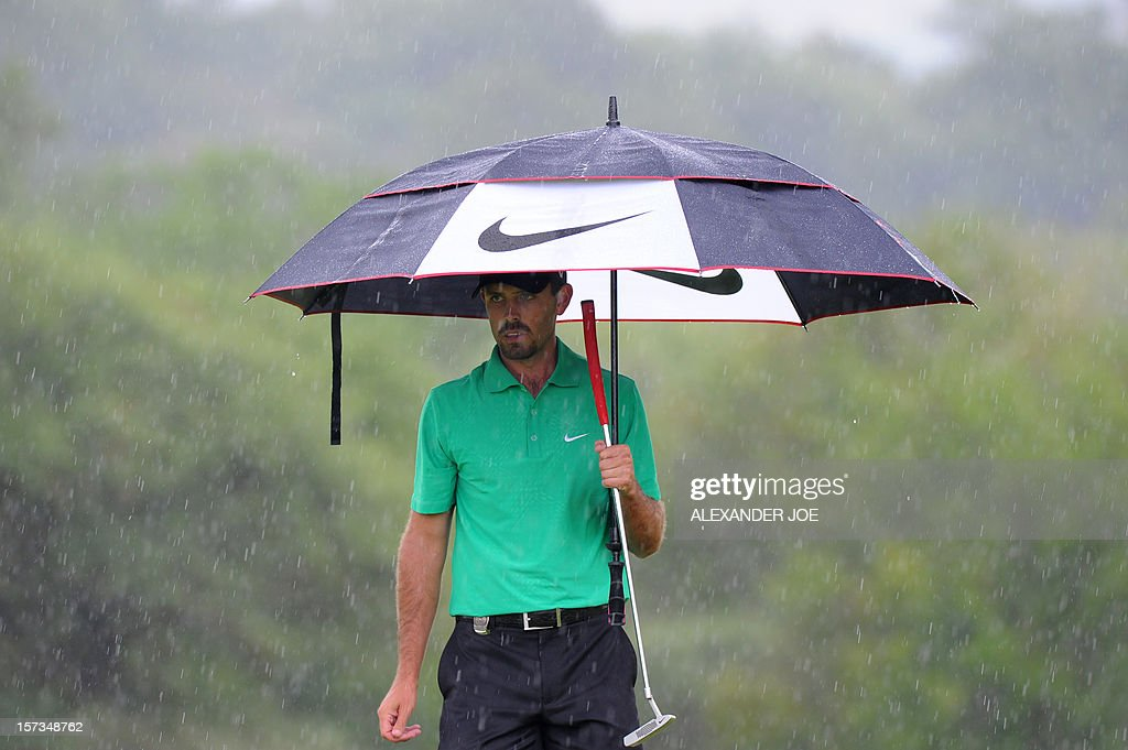 Charl Schwartzel of South Africa, who finished second, gets ready to play a shot on the 7th during the 2012 Nedbank Golf Challenge in Sun City on December 2 ,2012.. AFP PHOTO / Alexander Joe