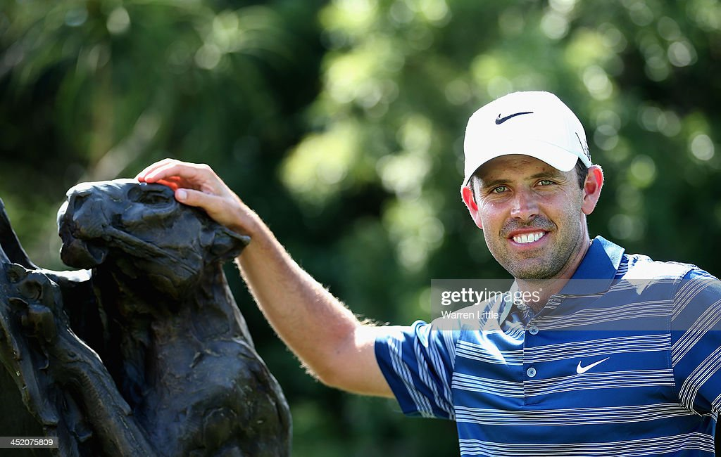 <a gi-track='captionPersonalityLinkClicked' href=/galleries/search?phrase=Charl+Schwartzel&family=editorial&specificpeople=213793 ng-click='$event.stopPropagation()'>Charl Schwartzel</a> of South Arica poses ahead of the Alfred Dunhill Championship at Leopard Creek Country Club on November 26, 2013 in Malelane, South Africa.