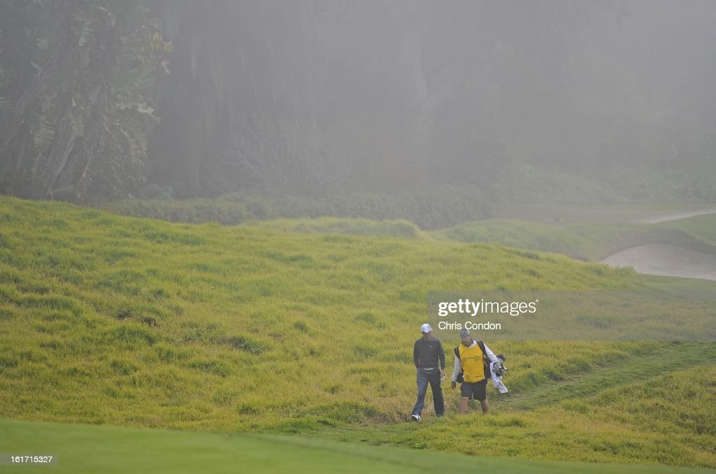 Charl Schwarzel of South Africa walks to the 8th green during the first round of the Northern Trust Open at Riviera Country Club on February 14, 2013 in Pacific Palisades, California.