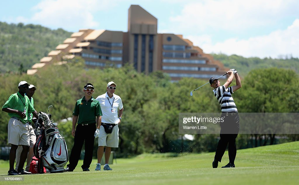 Charl Shwartzel and Louis Oosthuizen of South Africa have a practice round ahead of the Nedbank Golf Challenge at the Gary Player Country Club on November 27, 2012 in Sun City, South Africa.