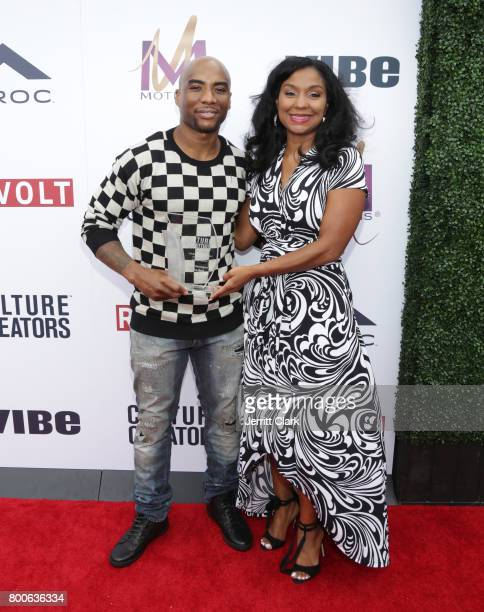Charlamagne tha God receives an award from Joi Brown during Culture Creators 2nd Annual Awards Brunch Presented By Motions Hair And Ciroc at Mr C...