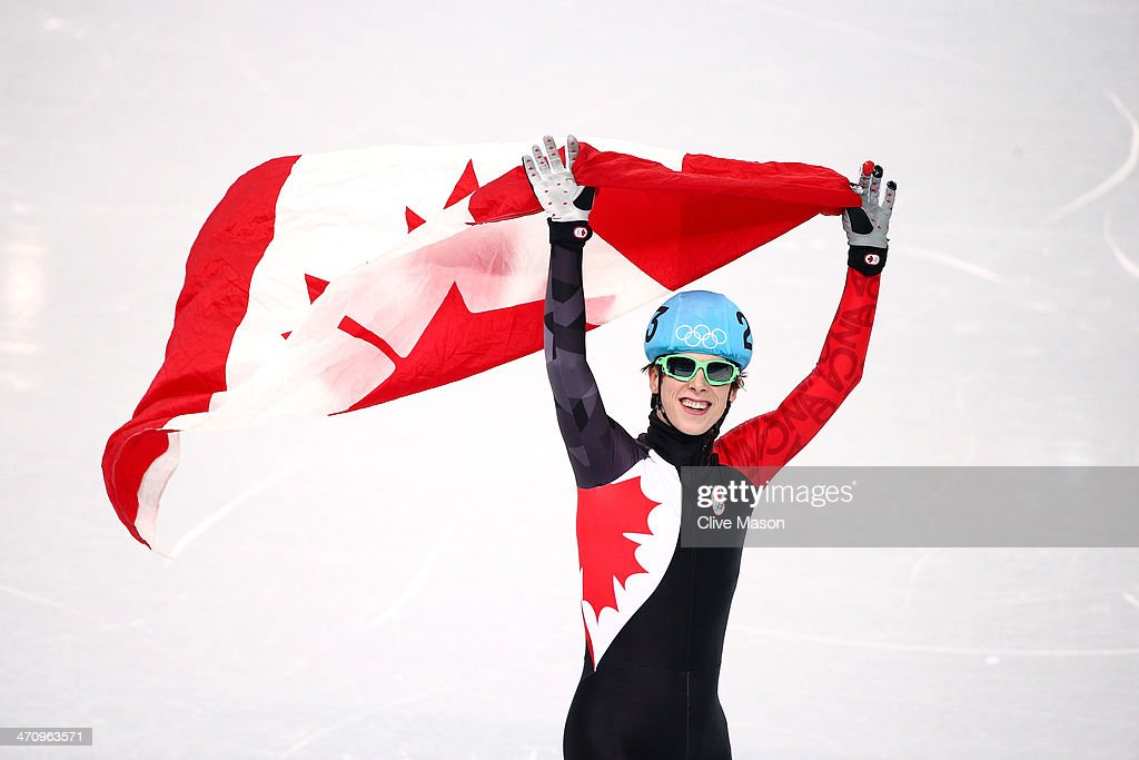 Charle Cournoyer of Canada celebrates winning the bronze medal in the Short Track Men's 500m Final A on day fourteen of the 2014 Sochi Winter...