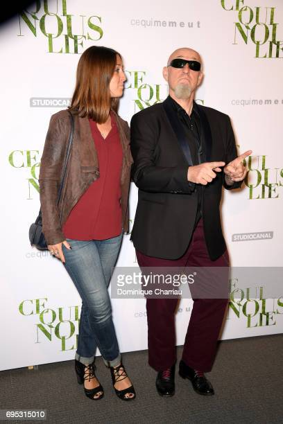 Charlelie Couture and his daughter Yamee attend the 'Ce Qui Nous Lie' Paris Premiere at Cinema UGC Normandie on June 12 2017 in Paris France
