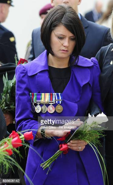 Charlene Birch whose husband Cpl Mark Birch was one of the armed forces killed pays her respects after a Ceremony to mark the addition of the names...