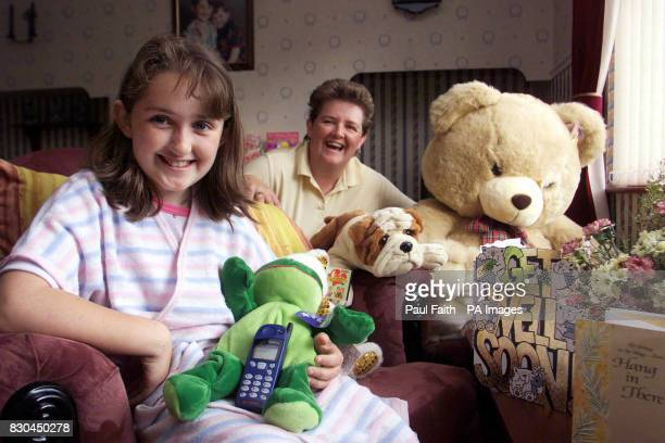 Charlene Daly at home surrounded by toys and gifts in Coleraine Co Londonderry with her mother Yvonne Charlene was injured during the loyalist feud...