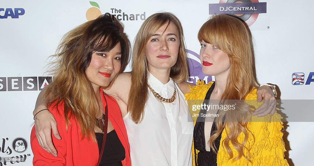 Charlene Kaye, Erin Marsz and Emmy Wildwood from Guns N' Hoses attend the Women In Music presents their 2013 holiday party at Le Poisson Rouge on December 4, 2013 in New York City.