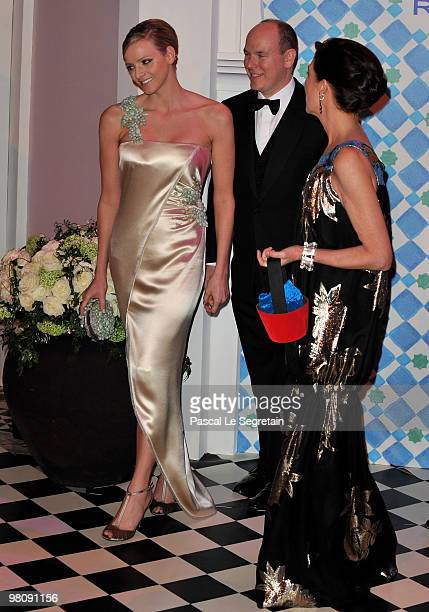 Charlene Wittstock Prince Albert II of Monaco and Princess Caroline of Hanover arrive to attend the Monte Carlo Morocco Rose Ball 2010 held at the...