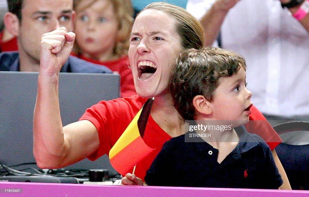 Belgium's Justine HeninHardenne and Mateo Rodriguez son of Henin's coach Carlos Rodriguez support teammate Kirsten Flipkens during her single match...