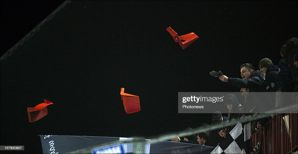 SC Charleroi supporters react and throw broken seats during the Jupiler League match between Standard de Liege and Sporting Charleroi on December 7, 2012 in Liege, Belgium.