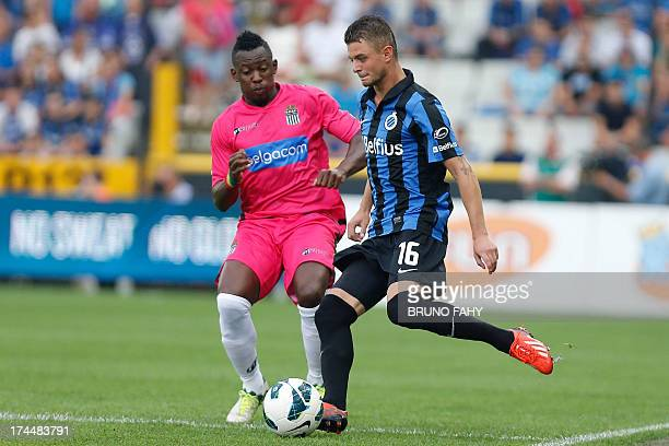 Charleroi's Congolese defender Francis N'Ganga and Club Brugge's Belgian midfielder Maxime Lestienne vie for the ball during the Jupiler Pro League...
