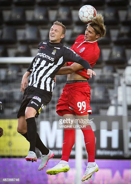 Charleroi's David Pollet and Luhansk's Andriy Pylyavskyi vie for the ball during the UEFA Europa League third qualifying round footbal match between...