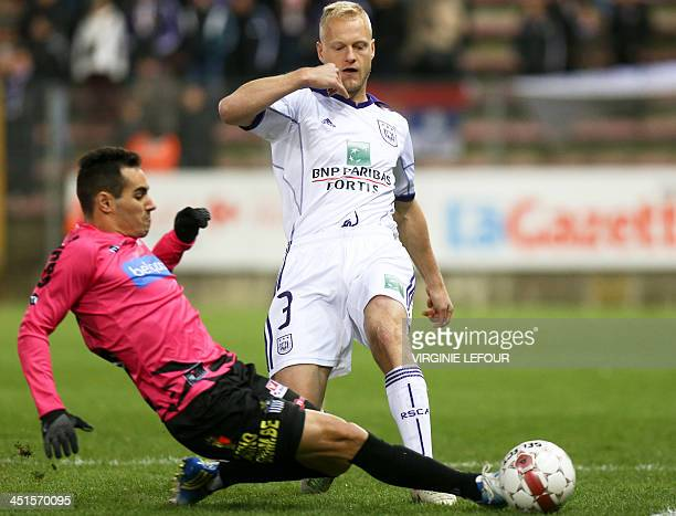 Charleroi's Stergos Marinos and Anderlecht's Olivier Deschacht fight for the ball on November 23 2013 during a Jupiler Pro League match in Charleroi...