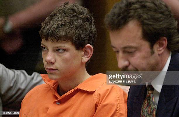 Charles 'Andy' Williams a 15year old student from Santana High School sits with his attorney Randy Mize during his arraignment for murder in the...