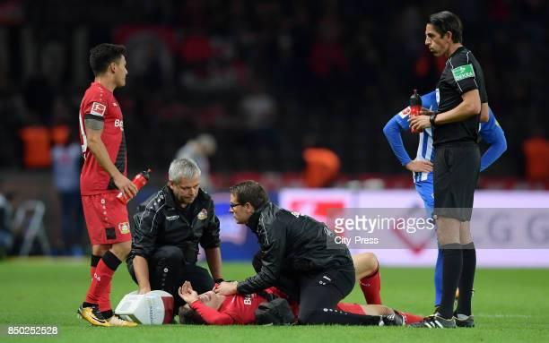 Charles Aranguiz Kai Havertz physiotherapist Sven Elsinger team doctor Dr Philipp Ehrenstein of Bayer 04 Leverkusen and referee Deniz Aytekin during...