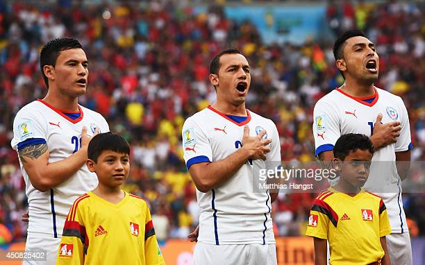 Charles Aranguiz Marcelo Diaz and Gonzalo Jara of Chile sing the National Anthem during the 2014 FIFA World Cup Brazil Group B match between Spain...
