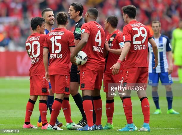 Charles Aranguiz of Bayer 04 Leverkusen Vedad Ibisevic of Hertha BSC Julian Baumgartlinger of Bayer 04 Leverkusen referee Deniz Aytekin Jonathan Tah...