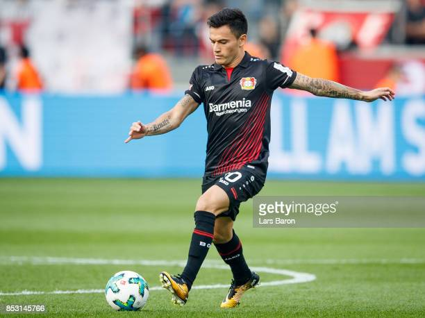Charles Aranguiz of Bayer Leverkusen runs with the ball during the Bundesliga match between Bayer 04 Leverkusen and Hamburger SV at BayArena on...