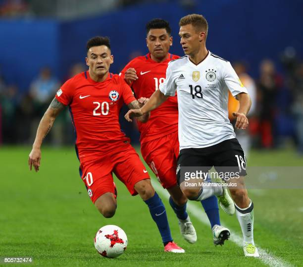 Charles Aranguiz of Chile and Joshua Kimmich of Germany battle for possession during the FIFA Confederations Cup Russia 2017 Final between Chile and...