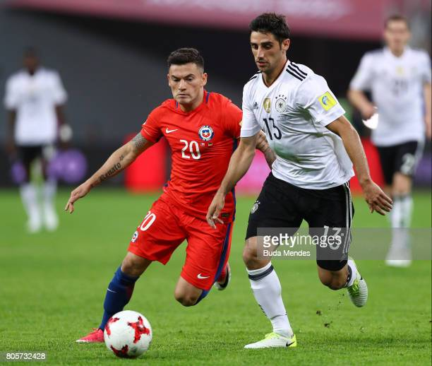 Charles Aranguiz of Chile and Lars Stindl of Germany battle for possession during the FIFA Confederations Cup Russia 2017 Final between Chile and...