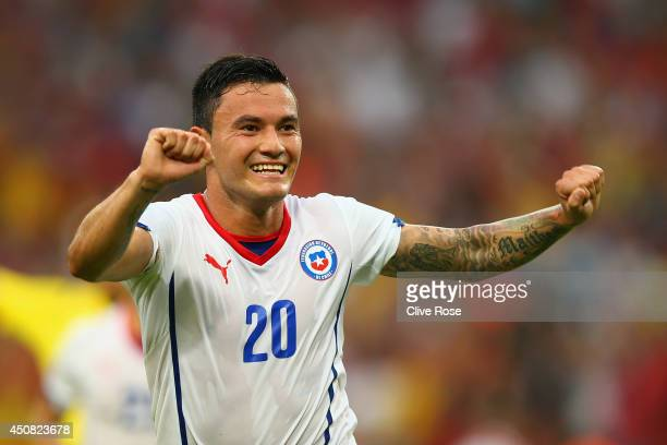 Charles Aranguiz of Chile celebrates scoring his team's second goal during the 2014 FIFA World Cup Brazil Group B match between Spain and Chile at...