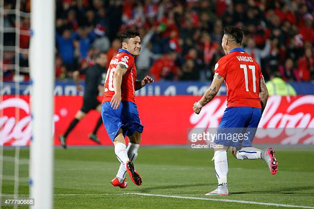 Charles Aranguiz of Chile celebrates with teammate Eduardo Vargas after scoring the opening goal during the 2015 Copa America Chile Group A match...
